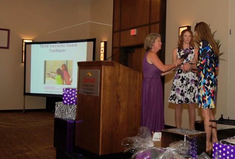 Receiving The Well Armed Woman Instructor ``Trailblazer Award`` from Carrie Lightfoot, Founder